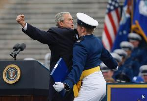 President George W. Bush and U.S. Air Force Academy graduate Theodore Shiveley of Plano, Texas, bump chests after Shiveley receives his diploma on May 28, 2008. (AP/ Charles Dharapak)