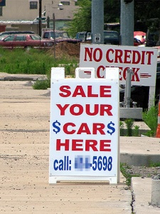 """Like this sign. It's """"sell,"""" numb-nuts."""