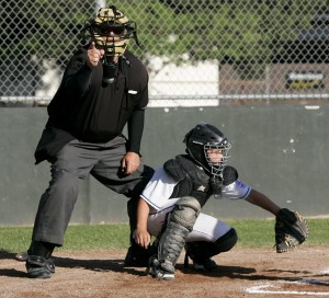 Kevin Dwelly calls a strike during a Little League game. Hank Schoeningh is the catcher. (Photo by Scott Manchester/Sonoma Press Democrat)