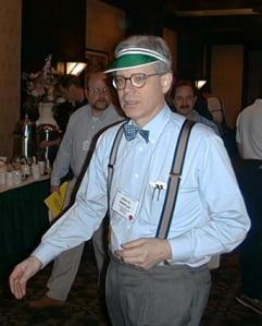 Stalwart copy editor John McIntyre of The Baltimore Sun models a green eyeshade at the 2000 ACES conference. Not many of us wear them anymore, or bow ties and suspenders either. Image from poynter.org.