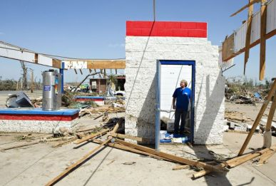 Ken Sullivan, general manager of We Willies Super Auto Wash, looks over the damage after a tornado tore through the area for the second time in three years in Vilonia. Photo: Wesley Hitt, Getty Images