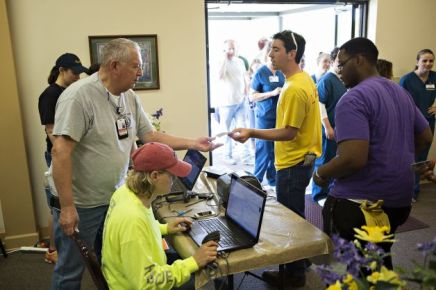 Ken Brown hands out IDs Monday at Beryl Baptist Church to volunteers after a tornado Sunday tore through the Vilonia area for the second time in three years. Wesley Hitt, Getty Images.