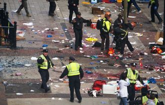 Police and emergency workers investigate after the April 15, 2013, bombing at the Boston Marathon that killed Martin Prince, Krystle Campbell and Lu Lingzi. Image from Wikipedia.