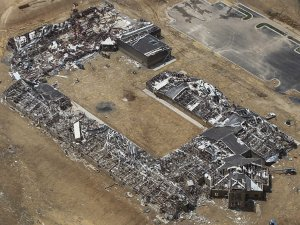 The new Vilonia Intermediate School was nearly completely flattened by the Sunday tornado. Image by Carlo Allegri, Reuters.