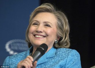 The cat out of the bag, Grandma-to-be Hillary could smile and joke.  Image by Andrew Kelly, Reuters.