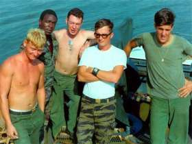 "John Kerry (far right) with some of his crew aboard a ""swift boat"" on the Mekong River during the Vietnam War. Image from KRT."