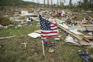A flag flies amid the debris after the Vilonia tornado. Image by Wesley Hitt, Getty Images.