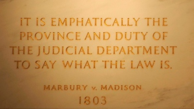 Inscription on the wall of the Supreme Court Building from Marbury v. Madison, in which Chief Justice John Marshall outlined the concept of judicial review. Image from Wikimedia Commons.