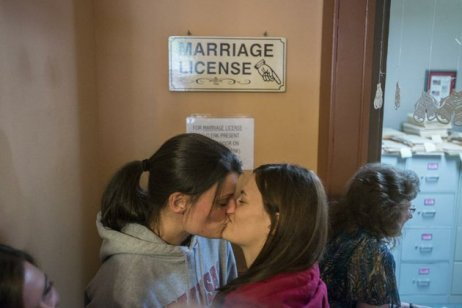 Kristin Seaton, left, and Jennifer Rambo, kiss while waiting for their marriage license Saturday at the Carroll County Courthouse in Eureka Springs. The Fort Smith couple were first in line and were later married outside the courthouse. Photo by Alexander Reyes, NWA Media.