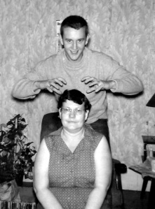 It looks like Daddy's getting ready to give Nanny a head massage.