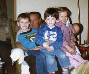A lap full of grandkids: David, his brother Matt, and Sarah and her brother Derek sit on their Grandpa.