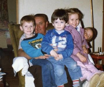 Daddy's in there, buried under grandkids David, Matt, Sarah and Derek.
