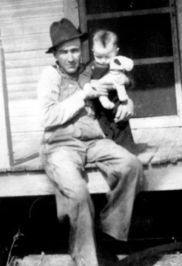 Grandpa Carl, who died three years before I was born, holding my dad.