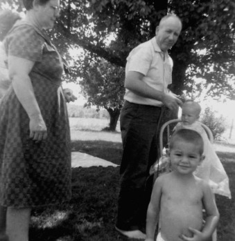 Grandpa used to give my brothers haircuts so they'd just have fuzz (just like him). Mitch (in front) already had his, and Kevin's in the chair.