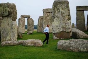 Well, he DID visit Stonehenge last week ... Image by Charles Dharapak, AP.