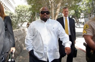 Cee Lo Green leaves Los Angeles Superior Court after a hearing on Aug. 29. He pleaded no contest to drug charges and received three years' probation and community service. Image by Nick Ut, AP.
