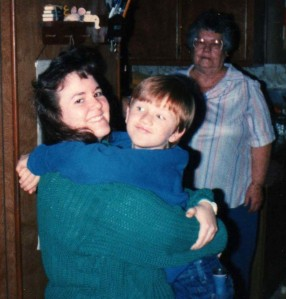 David gives his Aunt Brenda a hug while his great-grandma looks on.