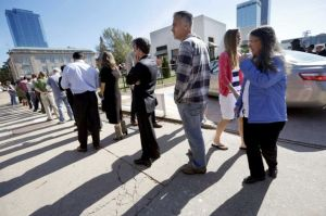 Voters wait in line to vote early in Little Rock on Monday. Image by Danny Johnston, AP.