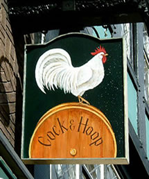 The Phrase Finder thinks the existence of several pub signs going back to at least the 14th Century, showing a chicken and a hoop, is the more likely origin. Image found on The Phrase Finder.