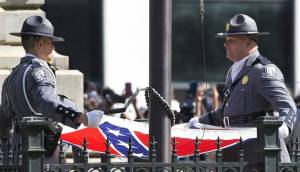A South Carolina Highway patrol honor guard lowers the Confederate battle flag as it is removed from the Capitol grounds  July 10 in Columbia, S.C., to the cheers of thousands.  Image by John Bazemore, AP, found on sacbee.