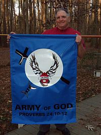 Spokesman Donald Spitz holds an Army of God banner. Eric Rudolph must be so proud. Image found on Wikipedia.