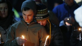 Colorado Springs locals mourn at a candlelight vigil for the victims. Image by David Zabulowski, Associated Press.