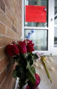 Roses stand outside the door of the Planned Parenthood clinic in Colorado Springs. Image by David Zalubowski, Associated Press.