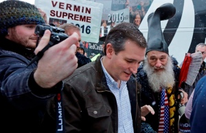 No, Vermin's the guy on the right with the boot and the giant toothbrush talking to some other crazy in New Hampshire. Image by Elise Amendola, Associated Press, found on Dallas News Trailblazers blog.