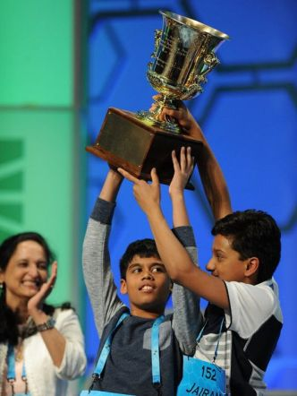 Careful, Jairam ... it looks like Nihar is contemplating tipping that trophy over onto your head. Image by Christopher Powers, USA Today.