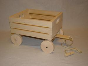 I imagine George's wagon looked a bit like this; simple, but made with love. Image found on My Unique Wooden Toys.